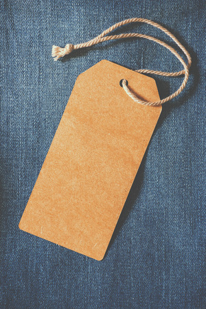 Photo for Empty brown paper tag of jean.  - Royalty Free Image