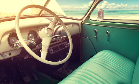Foto de Interior of classic vintage car -parked seaside in summer - Imagen libre de derechos