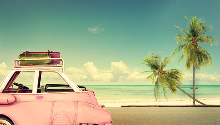 Photo pour Travel destination: vintage classic car parked near the beach with bags on a roof - Honeymoon trip in summer - image libre de droit