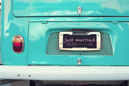 Photo pour just married sign on aquamarine classic vintage van. concept of love - wedding and honeymoon in summer - image libre de droit