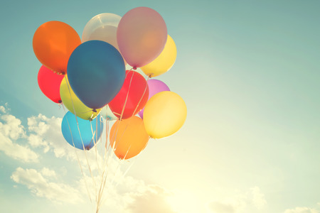 Photo pour multicolor balloons with a retro instagram filter effect, concept of happy birthday in summer and wedding honeymoon party (Vintage color tone) - image libre de droit