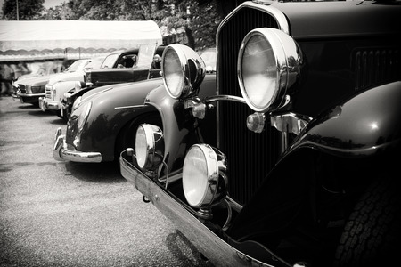 Photo pour Black and white photo of classic car- vintage film grain filter effect styles - image libre de droit