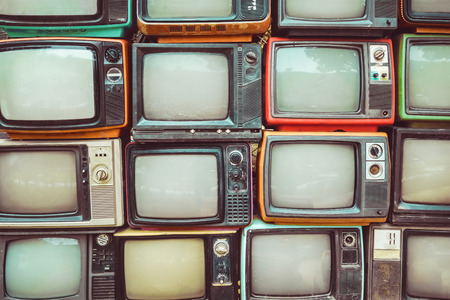 Foto de Pattern wall of pile colorful retro television (TV) - vintage filter effect style. - Imagen libre de derechos