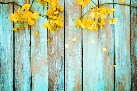 Photo for Yellow flowers on vintage wooden background, border design. vintage color tone - concept flower of spring or summer background - Royalty Free Image