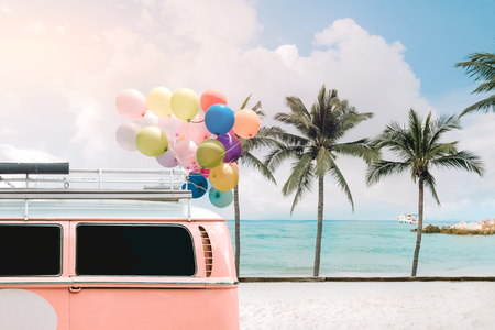 Foto de Vintage card of van with colorful balloon on beach blue sky concept of love in summer and wedding honeymoon - Imagen libre de derechos