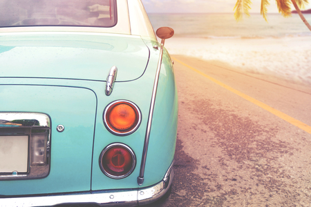 Photo for Journey of beach holiday - Rear of classic car parked side beach in summer. vintage retro color effect styles - Royalty Free Image