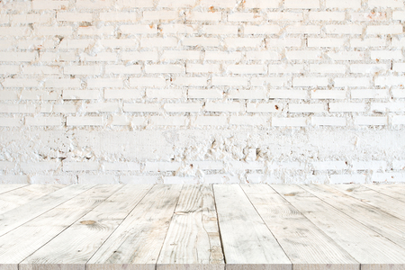 Photo pour Empty clear white wood table for product placement or montage, perspective style. vintage white brick wall background. - image libre de droit