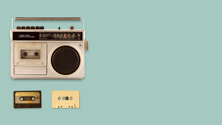 Foto de Radio cassette recorder and player with music tape cassette on color background. retro technology. flat lay, top view hero header. vintage color styles. - Imagen libre de derechos