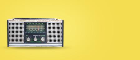 Foto de Vintage radio on pastel color background. retro technology. flat lay, top view hero header. vintage color styles. - Imagen libre de derechos