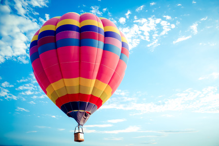 Foto de Colorful hot air balloon flying on sky. travel and air transportation concept - balloon carnival in Thailand - Imagen libre de derechos