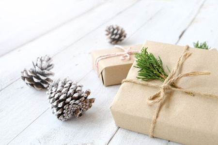 Photo for Christmas background - Craft and handmade Christmas present (gift boxes) and rustic decoration. Vintage style. Selective focus and shallow. - Royalty Free Image