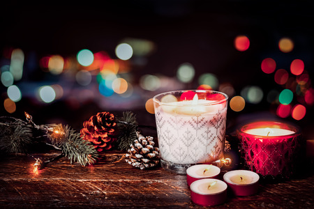 Photo for Christmas background - Christmas candle and rustic decoration on wood table with christmas lights background in night party. vintage color style. - Royalty Free Image