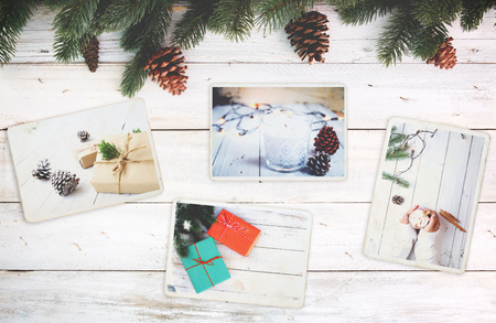 Photo for Photo album in remembrance and nostalgia in Christmas (winter season) on wood table. photo of retro camera - vintage and retro style, topview - Royalty Free Image