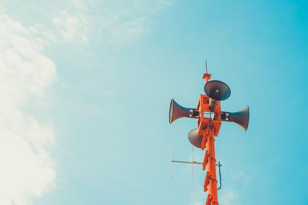 Photo pour vintage horn speaker - public relations sign and symbol. vintage color tone effect - image libre de droit