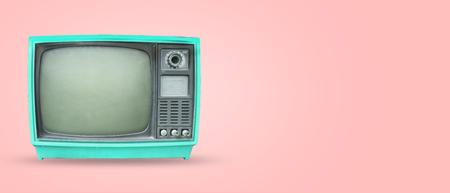 Foto de Retro television - old vintage tv on pastel color background. retro technology. flat lay, top view hero header. vintage color styles.  - Imagen libre de derechos