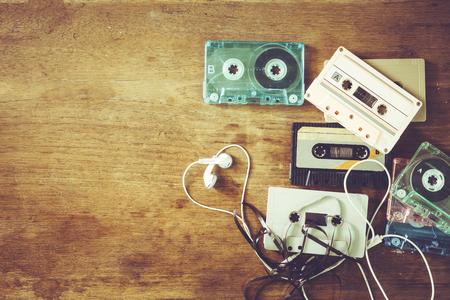 Foto de Retro technology of cassette recorder music with retro tape cassette on wood table. Vintage color effect styles. - Imagen libre de derechos