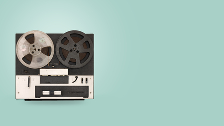 Foto de Tape cassette recorder and player with on color background. retro technology. flat lay, top view hero header. vintage color styles. - Imagen libre de derechos