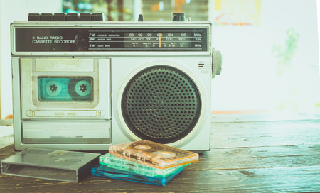 Foto de Retro lifestyle - tape cassette with cassette player and recorder for listen music - vintage color tone effect. - Imagen libre de derechos
