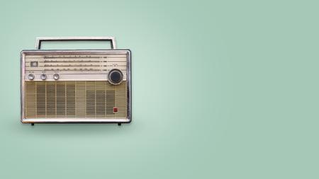 Foto de Vintage radio on color background. retro technology. flat lay, top view hero header. vintage color styles. - Imagen libre de derechos