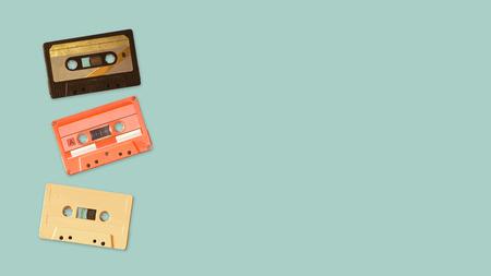 Foto de Tape cassette recorder on color background. retro technology. flat lay, top view hero header. vintage color styles. - Imagen libre de derechos