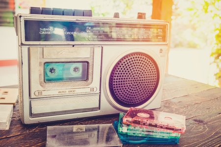 Photo for Retro lifestyle - tape cassette with cassette player and recorder for listen music - vintage color tone effect. - Royalty Free Image