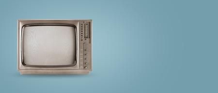 Foto de Retro television - old vintage tv on color background. retro technology. flat lay, top view hero header. vintage color styles.  - Imagen libre de derechos