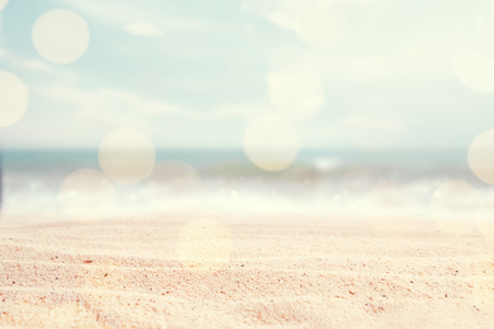 Foto de A seascape abstract beach background. blur and bokeh light of lens flare, pastel colors in a vintage and retro style. Focus on foreground - Imagen libre de derechos