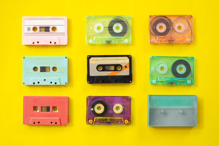 Photo for Set of vintage tape cassette recorder on yellow background, flat lay, top view. retro technology - Royalty Free Image
