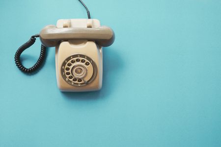 Photo for vintage telephone on blue background, flat lay, top view. retro technology - Royalty Free Image