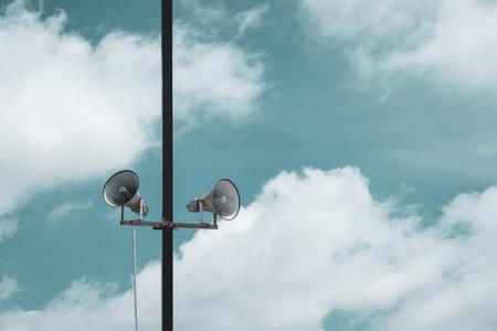 Photo pour Broadcast speaker for public relation. vintage horn speaker over blue sky with clouds. - image libre de droit