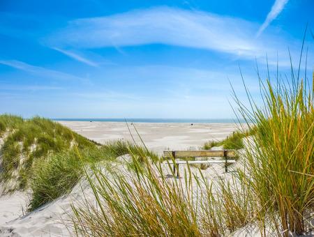 Foto de Beautiful dune landscape and long beach on the island of Amrum at North Sea, Schleswig-Holstein, Germany - Imagen libre de derechos
