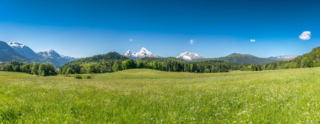 Photo for Beautiful mountain landscape in the Bavarian Alps with village of Berchtesgaden and Watzmann massif in the background at sunrise, Nationalpark Berchtesgadener Land, Bavaria, Germany - Royalty Free Image