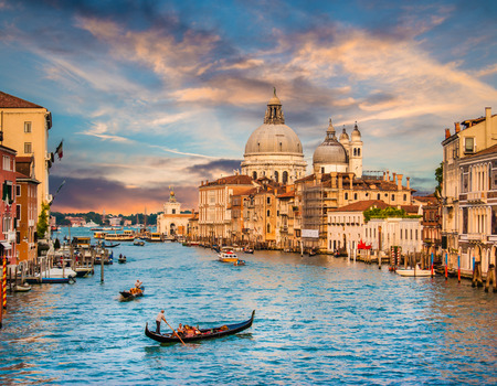 Photo for Beautiful view of traditional Gondola on famous Grand Canal with Basilica di Santa Maria della Salute in golden evening light at sunset in Venice, Italy - Royalty Free Image