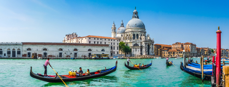 Foto de Beautiful view of traditional Gondolas on Canal Grande with historic Basilica di Santa Maria della Salute in the background on a sunny day in Venice, Italy - Imagen libre de derechos