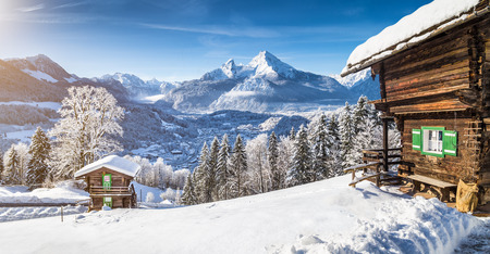 Photo for Panoramic view of beautiful winter wonderland mountain scenery in the Alps with traditional mountain chalets - Royalty Free Image