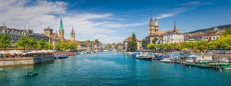 Foto de Panoramic view of historic Zurich city center with famous Fraumunster, Grossmunster and St. Peter and river Limmat at Lake Zurich on a sunny day with clouds in summer, Canton of Zurich, Switzerland - Imagen libre de derechos