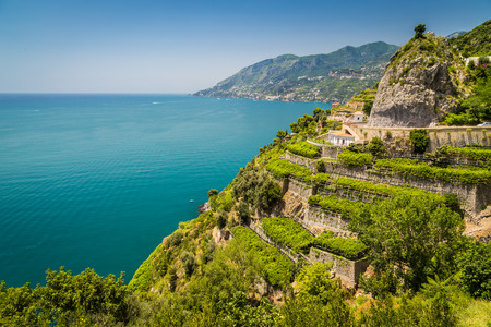 Foto de Panoramic picture-postcard view of famous Amalfi Coast with vineyards and Gulf of Salerno on a sunny day with blue sky in summer, Campania, Italy - Imagen libre de derechos