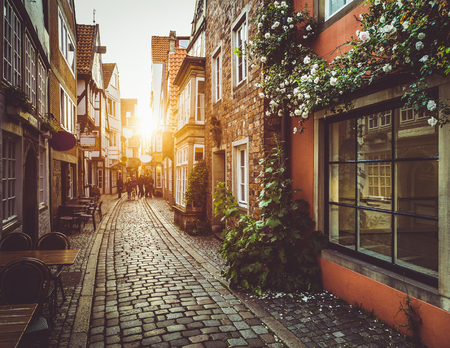Photo pour Beautiful view of old town in Europe in golden evening light at sunset in summer with pastel toned retro vintage style grunge filter and lens flare sunlight effect - image libre de droit