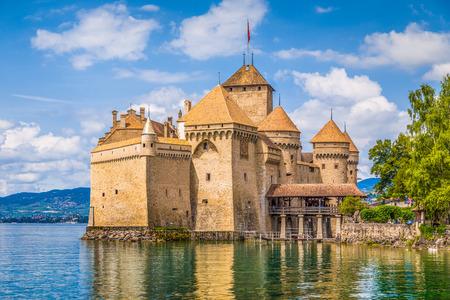 Foto de Classic view of famous Chateau de Chillon at beautiful Lake Geneva, one of Switzerland's major tourist attractions and most visited castles in Europe, Canton of Vaud, Switzerland - Imagen libre de derechos