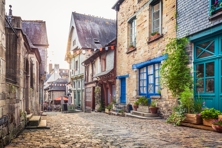 Photo pour Panoramic view of a charming street scene in an old town in Europe in beautiful evening light at sunset - image libre de droit