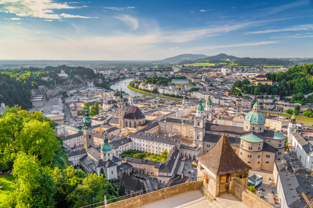 Photo for Aerial panoramic view of the historic city of Salzburg with Salzach river in beautiful golden evening light with blue sky and clouds at sunset in summer, Salzburger Land, Austria - Royalty Free Image