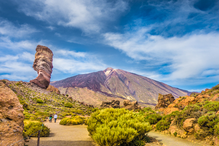 Photo for Panoramic view of unique Roque Cinchado unique rock formation with famous Pico del Teide mountain volcano summit in the background on a sunny day, Teide National Park, Tenerife, Canary Islands, Spain - Royalty Free Image