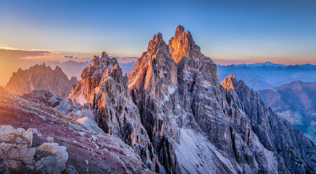 Photo for Panoramic view of famous Dolomites mountain peaks glowing in beautiful golden evening light at sunset in summer, South Tyrol, Italy - Royalty Free Image
