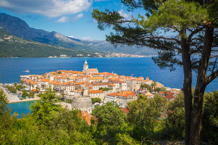 Foto de Beautiful view of the historic town of Korcula on a beautiful sunny day with blue sky and clouds in summer, Island of Korcula, Dalmatia, Croatia - Imagen libre de derechos