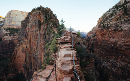 Foto de Panoramic view of famous Angels Landing hiking trail overlooking scenic Zion Canyon in beautiful post sunset evening twilight in summer, Zion National Park, Springdale, southwestern Utah, USA - Imagen libre de derechos