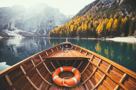Photo for Beautiful view of traditional wooden rowing boat on scenic Lago di Braies in the Dolomites in scenic morning light at sunrise, South Tyrol, Italy - Royalty Free Image