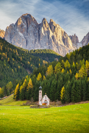 Photo pour Beautiful view of historic Church of St. Johann of Nepomuk with famous Odle Group mountain peaks in the Dolomites in beautiful evening light at sunset, South Tyrol, Italy - image libre de droit