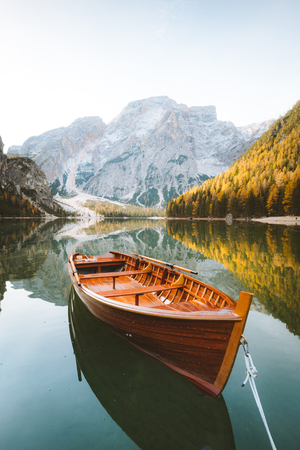 Foto de Beautiful view of traditional wooden rowing boat on scenic Lago di Braies in the Dolomites in scenic morning light at sunrise, South Tyrol, Italy - Imagen libre de derechos