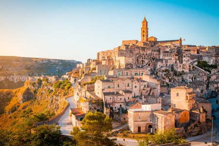 Photo for Panoramic view of the ancient town of Matera (Sassi di Matera) in beautiful golden morning light at sunrise, Basilicata, southern Italy - Royalty Free Image