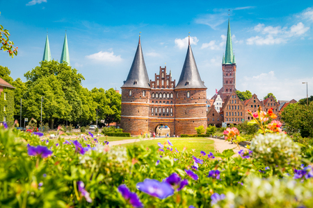 Foto de Classic postcard view of the historic town of Lübeck with famous Holstentor gate in summer, Schleswig-Holstein, northern Germany - Imagen libre de derechos